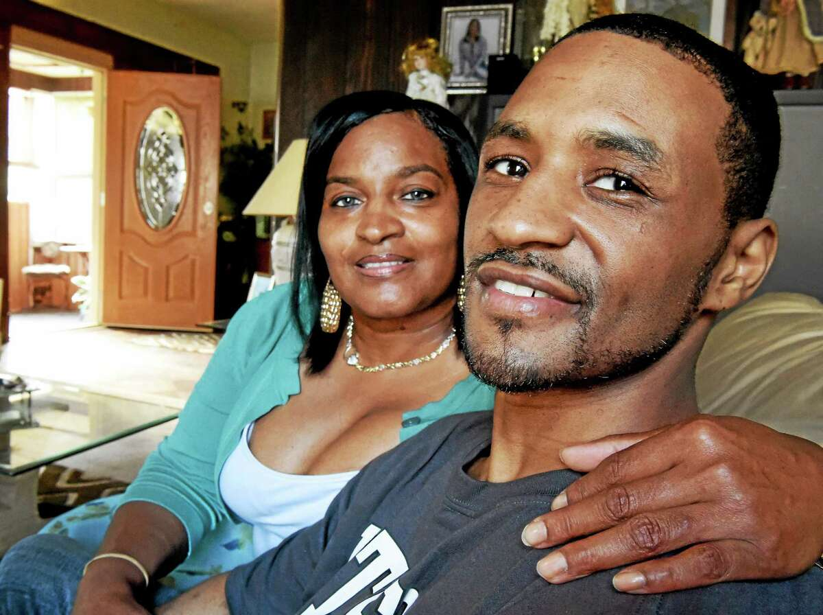 Jesse Cherry, 31, right, with his fiancee Tanya Howlett at Howlett's home in West Haven.