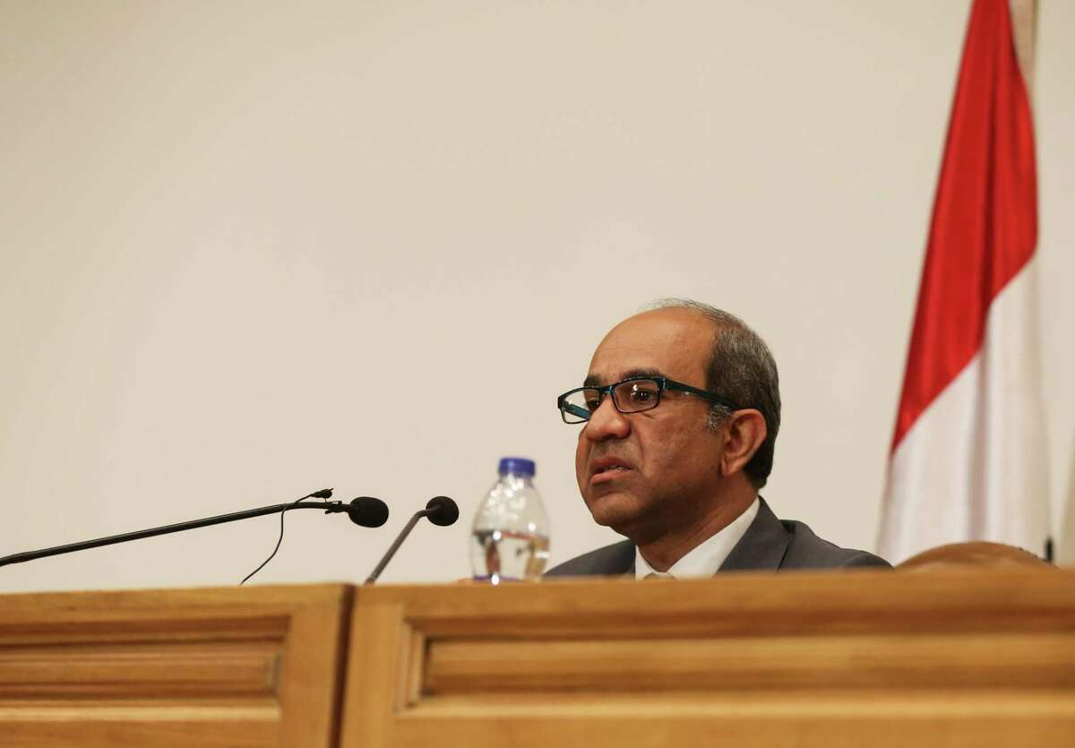 Ayman el-Muqadem, the head of the investigation team on a Russian plane crash last week in Egypt's Sinai, speaks during a press conference at the Aviation Ministry in the Nasr City neighborhood of Cairo, Egypt, Saturday, Nov. 7, 2015. El-Muqadem said a noise was heard in the last second of the cockpit voice recording from the plane that took off from Egypt's Red Sea resort of Sharm el-Shiekh, killing all 224 people onboard. He said an analysis of the noise was underway to identify its nature.