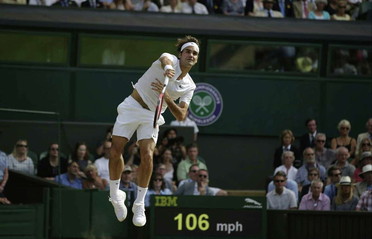 Roger Federer returns a shot to Andy Murray during their semifinal match on Friday at the All England Lawn Tennis Championships in Wimbledon, London.