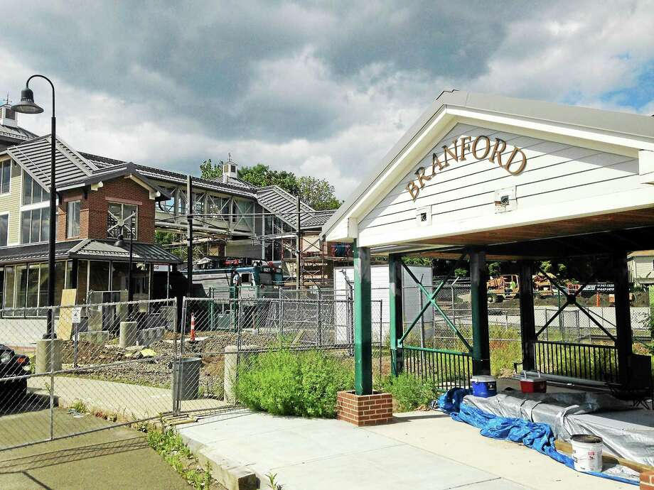 The state Department of Transportat aims to complete construction at the Branford train station by December. Photo: Juliemar Ortiz — New Haven Register