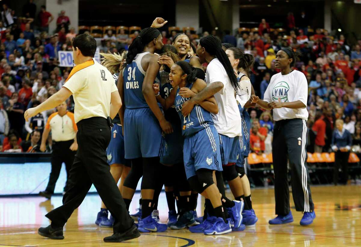 Minnesota Lynx forward Maya Moore celebrates with her teammates after hitting a buzzer-beater in Game 3 of the WNBA Finals on Friday night.