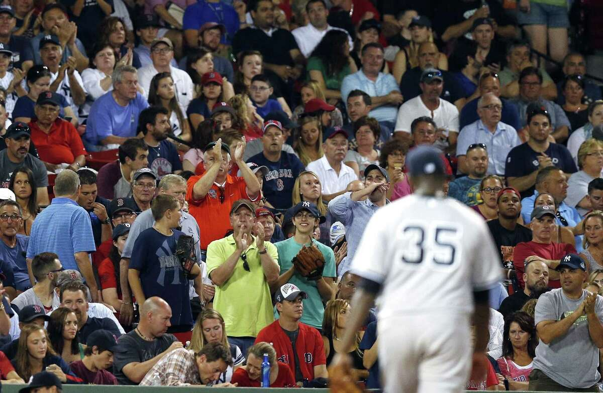 Michael Pineda (35) is saluted by Yankee fans as he walks off the field after being take out in the seventh inning of Friday's 5-1 win over the Red Sox in Boston.