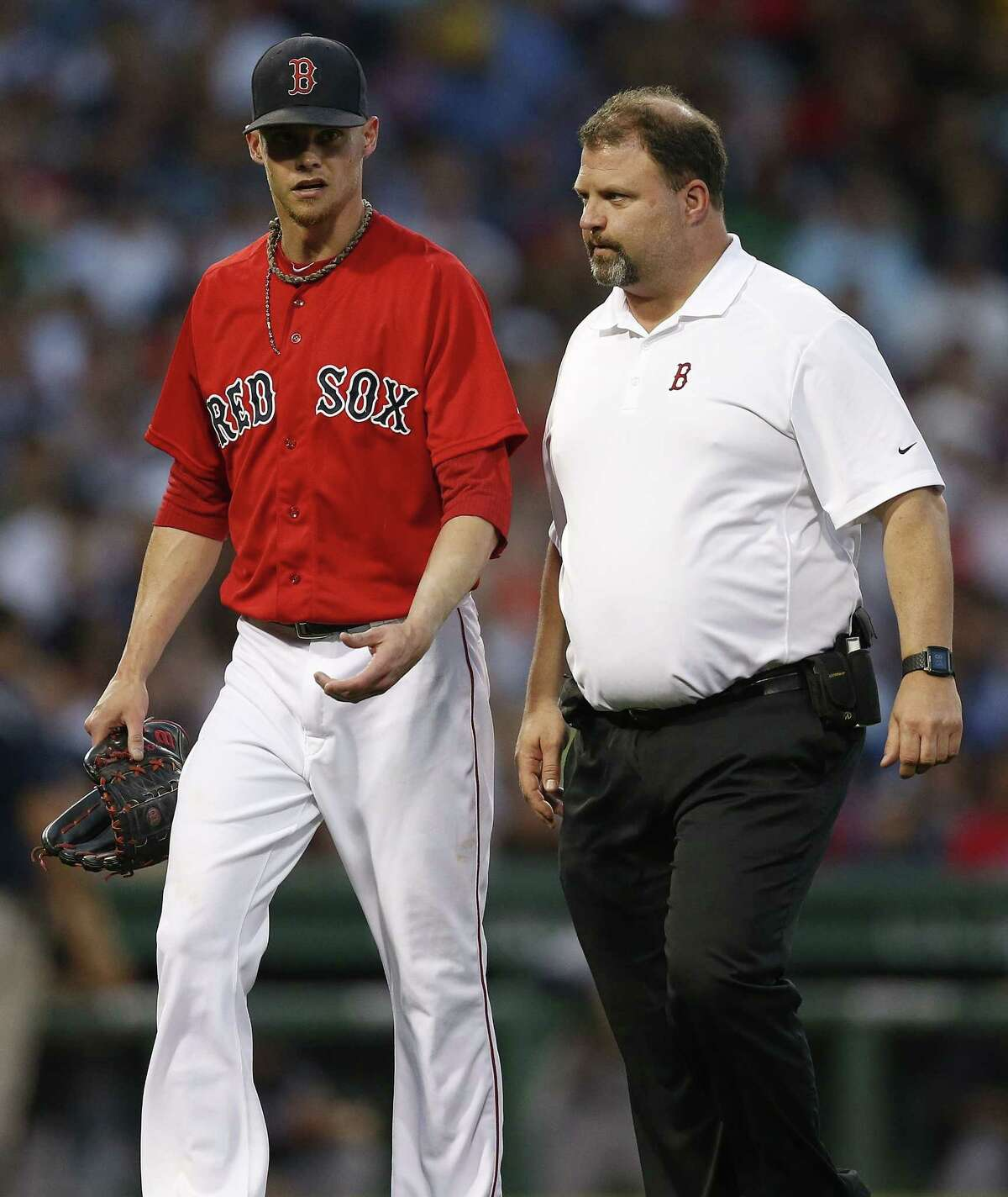 Red Sox starter Clay Buchholz leaves the game with a trainer during the fourth inning against the Yankees. Buchholz had elbow tightness