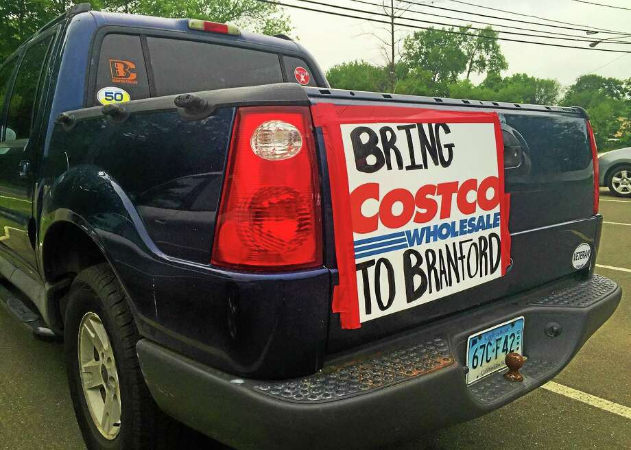A pickup truck bearing a sign supporting the addition of a Costco in Branford sits outside the Branford Fire Department on Thursday before the Planning and Zoning Commission meeting. Photo: Esteban L. Hernandez — New Haven Register