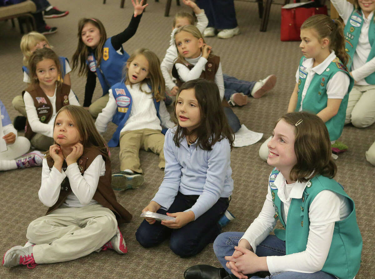 In this Thursday, Jan. 8, 2015 file photo, girls listen during the Girl Scout Troop 582's cookie training session at Beach Vineyard Church in Panama City Beach, Fla. As the Girl Scouts' membership continues a sharp decline, its leaders are betting on technology to reverse the trend, including a major expansion of its year-old program enabling Girl Scout cookies to be sold via mobile apps and the girls' personalized websites. The Digital Cookie upgrade, announced on Tuesday, Dec. 8, 2015 comes amid persisting challenges for the 103-year-old organization.