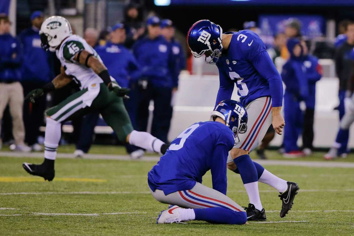 Giants kicker Josh Brown (3) reacts after missing a field goal in an overtime loss to the Jets on Sunday.