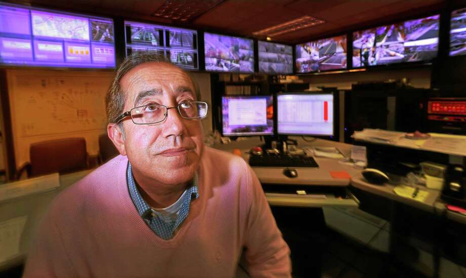 City of New Haven Traffic Management Center manned by Traffic Project Engineer Bijan Notghi (CQ) of New Haven's Transportation Traffic & Parking Department. The center has four walls of flat screen monitors that display 200 non-recording video detector cameras and 179 incident management multi-use cameras that record and store all video on a 15-day loop. Photo: Peter Hvizdak — New Haven Register   / ?2015 Peter Hvizdak