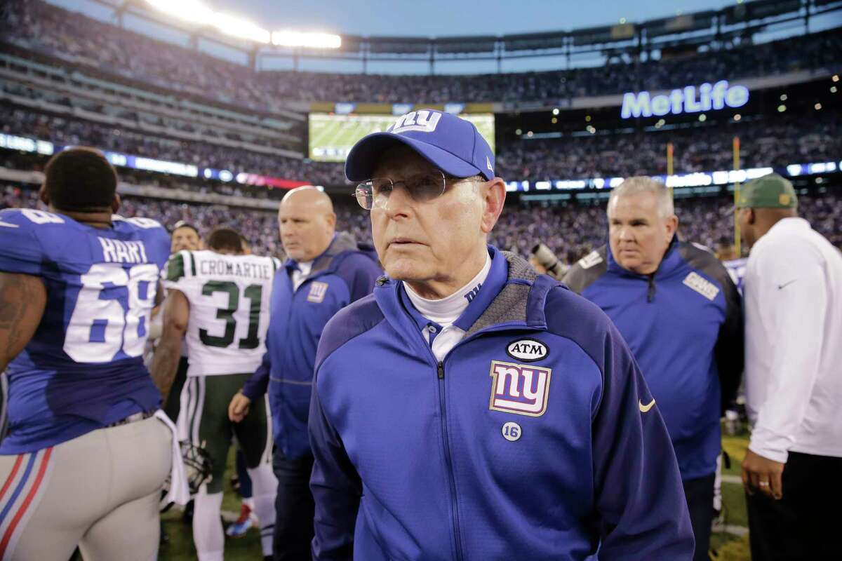 New York Giants head coach Tom Coughlin leaves the field after Sunday's loss to the Jets.