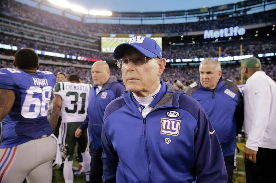New York Giants head coach Tom Coughlin leaves the field after Sunday's loss to the Jets. Photo: The Associated Press   / AP