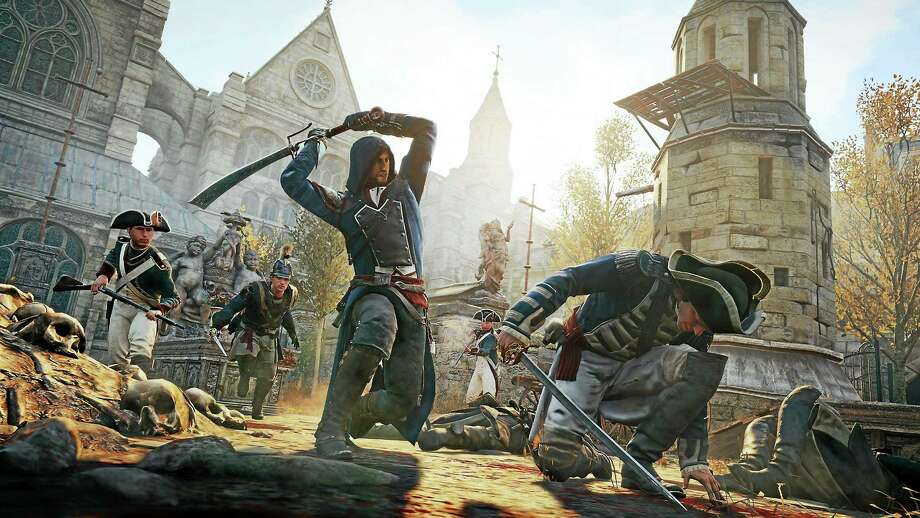 "In this photo provided by Ubisoft, a Parisian named Arno fights his way through the French Revolution in ""Assassin's Creed Unity."" Photo: AP Photo   / Ubisoft"