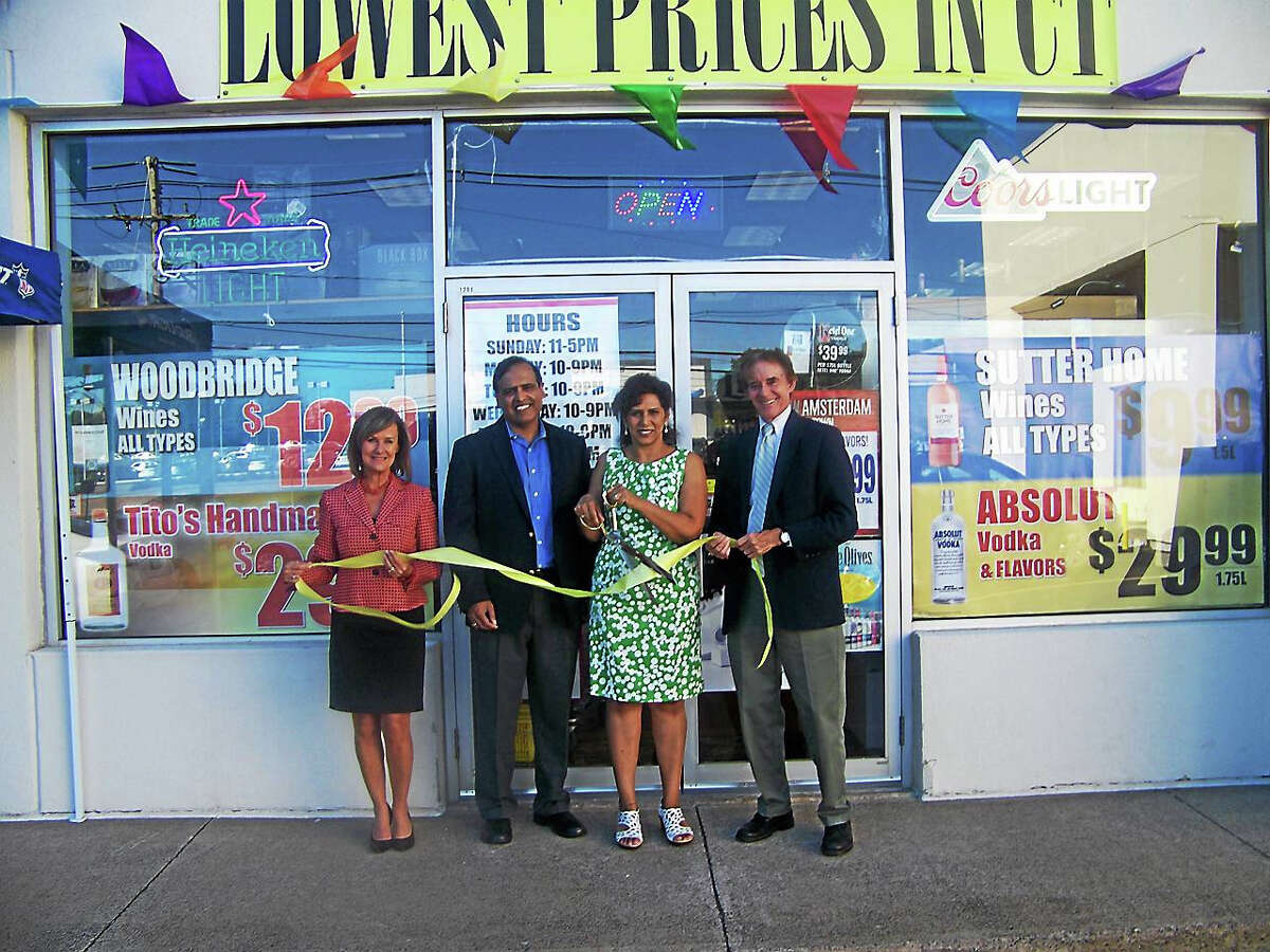 CONTRIBUTED PHOTO WINE KINGDOM OPENS: From left, Dee Prior-Nesti, executive director of the Quinnipiac Chamber of Commerce; the Gulatis, owners of Wine Kingdom; and Wallingford Mayor William W. Dickinson Jr. celebrate with a ribbon-cutting for the Wine Kingdom, 1211 S. Broad Street in Wallingford. To view a price list or learn more about the Wine Kingdom, visit www.winekingdomct.com or call 203-278-4340.