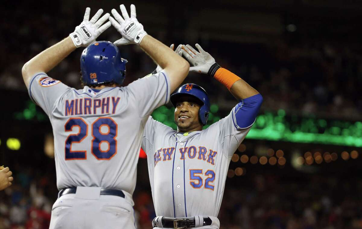 The Mets' Daniel Murphy celebrates with Yoenis Cespedes (52) after Cespedes' two-run home run during the eighth inning against the Washington Nationals Wednesday. The Mets won 5-3.