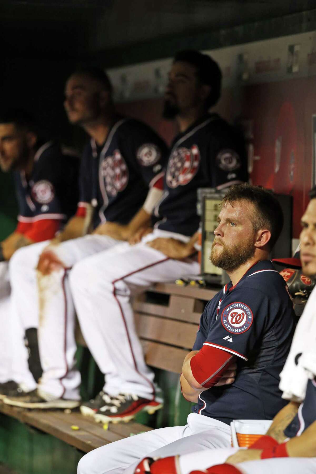 A dismayed Washington Nationals relief pitcher Drew Storen, right, sits in the dugout after giving up Yoenis Cespedes' two-run home run the eighth inning.