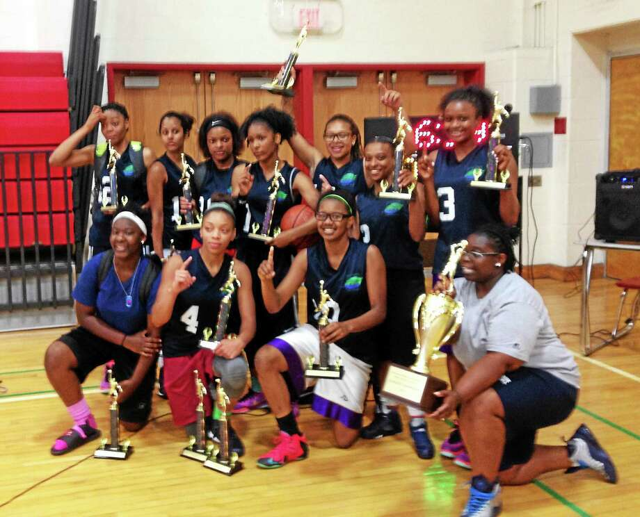 Hillhouse teammates pose with trophies after winning high school girlsí title in the 34th season of the New Haven Parks & Recreation Summer League. Photo: Jim Fuller — Register