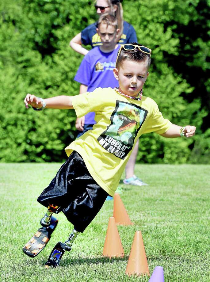 Braylon O'Neill, 6½, of Cranston, Rhode Island, maneuvers around cones during Camp No Limits at Quinnipiac University in Hamden Friday. Photo: Arnold Gold — New Haven Register