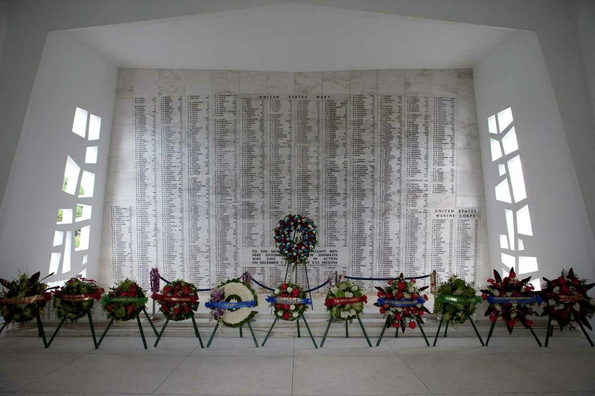 Wreaths stand in front of the memorial wall aboard The USS Arizona Memorial in Pearl Harbor, Hawaii, in this 2011 file photo on the 70th anniversary of the Japanese attack that brought the U.S. into World War II.