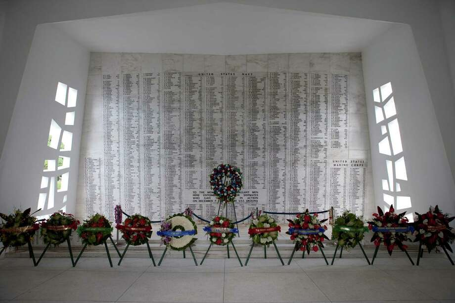 Wreaths stand in front of the memorial wall aboard The USS Arizona Memorial in Pearl Harbor, Hawaii, in this 2011 file photo on the 70th anniversary of the Japanese attack that brought the U.S. into World War II. Photo: AP File Photo   / 2011