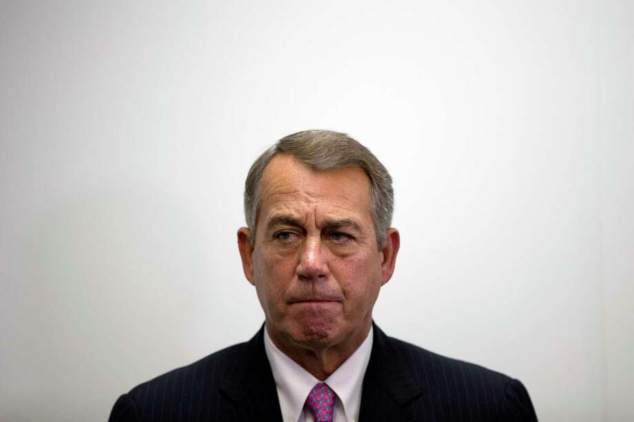 In this Oct. 7, 2015, photo, outgoing House Speaker John Boehner of Ohio listens as House Majority Leader Kevin McCarthy of Calif., speaks during a new conference on Capitol Hill in Washington. Boehner wants out. He really does. But the Ohio House Republican is staying put, for now _ and that could improve the chances for a debt limit increase by early next month to avoid a market-shattering government default and possibly a bipartisan budget deal to head off a government shutdown in December. Photo: (AP Photo/Evan Vucci) / AP