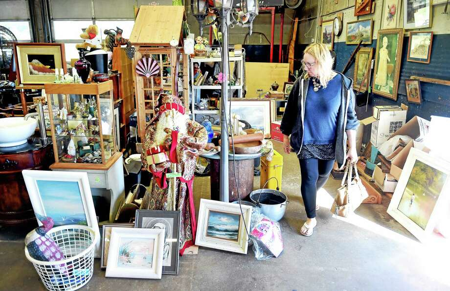 Robin Reed of Branford shops at the Grass Island Flea Market in Guilford on 10/4/2015. The market will close on Oct. 25. Photo: Arnold Gold — New Haven Register