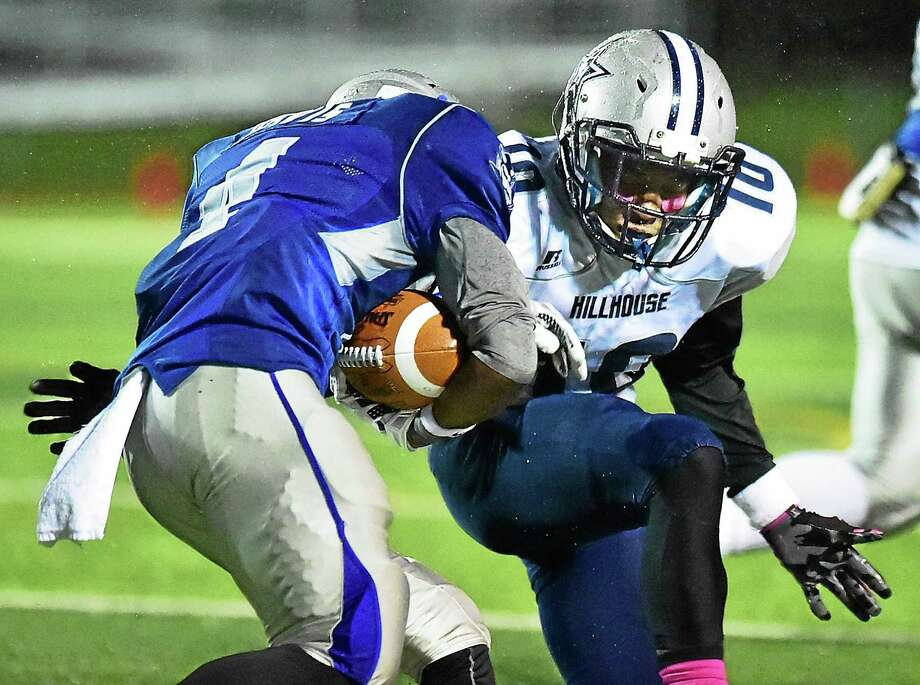 Hillhouse's Terron Mallory goes for a tackle in an earlier game this year. Photo: Catherine Avalone — New Haven Register / Catherine Avalone/New Haven Register