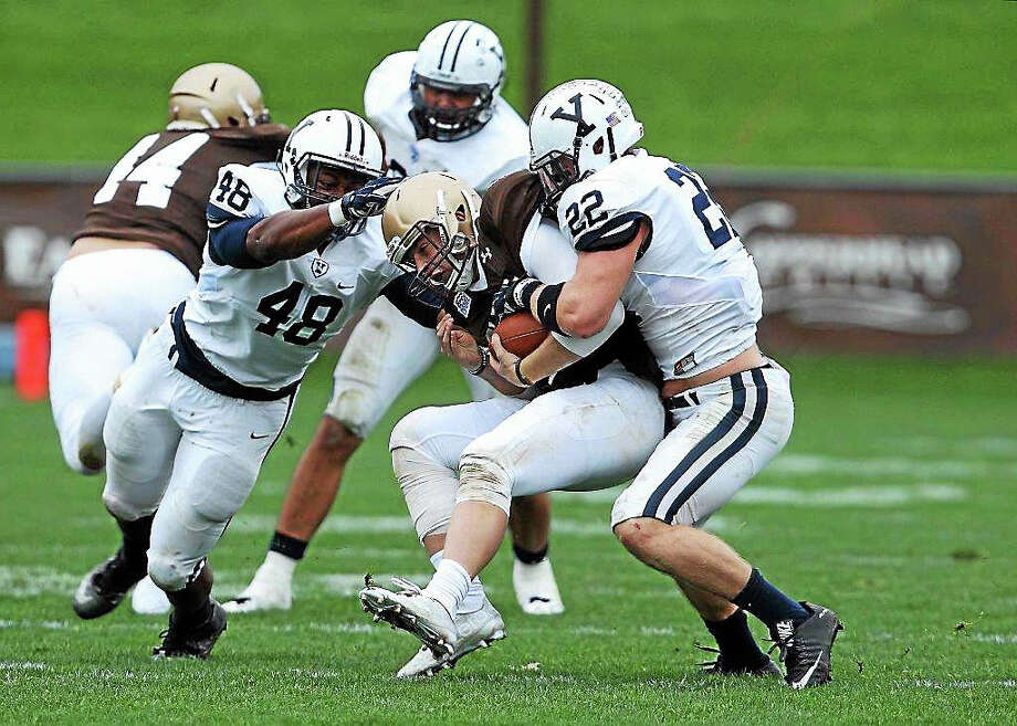 Yale's Matt Oplinger, right, makes a tackle during a game against Lehigh earlier this season. Photo: Photo Submitted By Yale