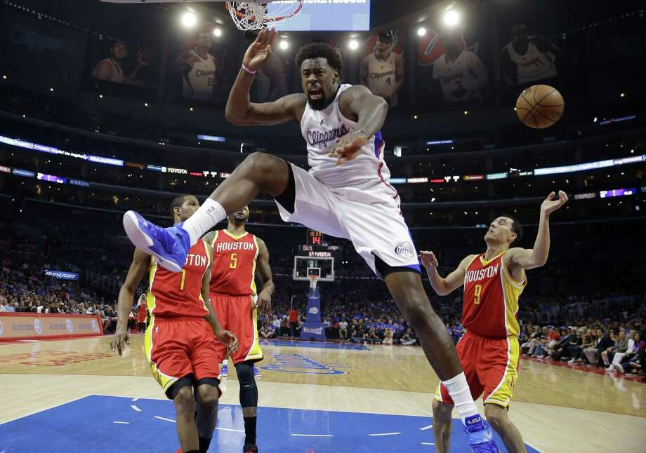 DeAndre Jordan gave the Dallas Mavericks his word. Then he gave the Los Angeles Clippers his signature. Photo: Jae C. Hong — The Associated Press File Photo   / AP