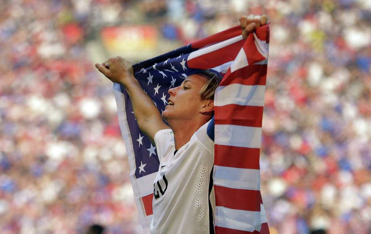 The United States' Abby Wambach holds an American flag after a 5-2 win over Japan in the final of the FIFA World Cup on Sunday in Vancouver.