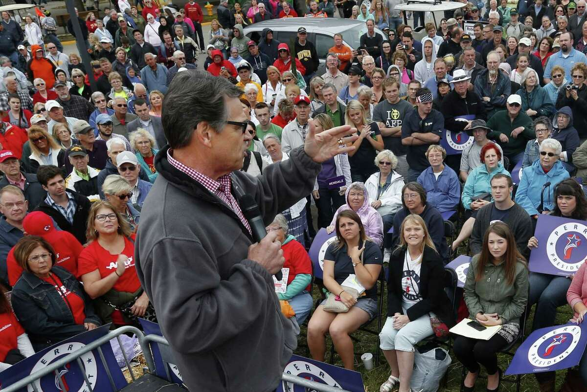 """In this Aug. 19, 2015, file photo, Republican presidential candidate, former Texas Gov. Rick Perry, speaks at the Iowa State Fair in Des Moines, Iowa. Perry has vowed to bring back the so-called """"enhanced interrogation"""" techniques if he is elected president."""