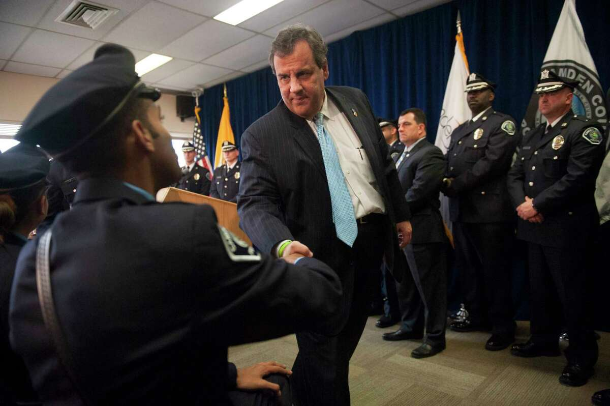 Gov. Chris Christie greets Camden County Police Officer Tyrrell Bagby after addressing the Camden County Police Force on the sweeping public safety reforms and the progress made together with the City of Camden to bring down crime, Monday, Nov. 2, 2015.
