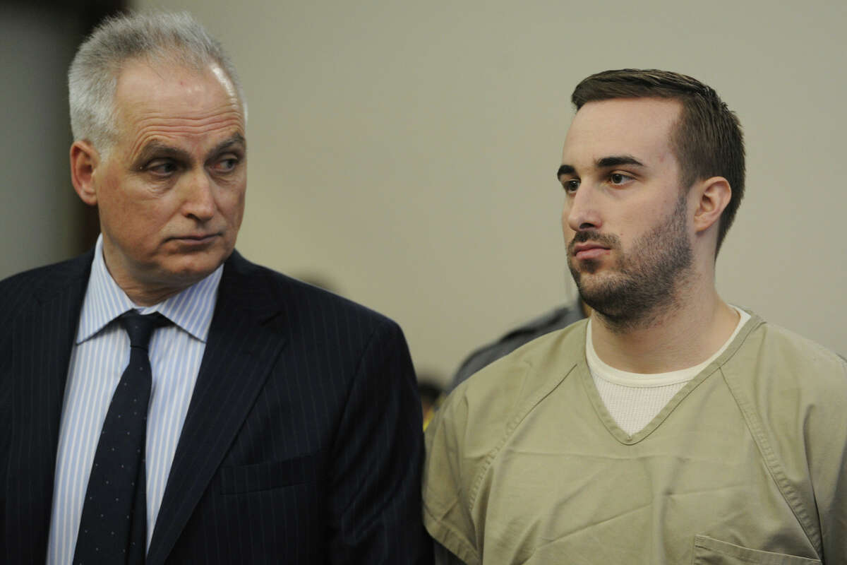 Kyle Navin, right, seen with his attorney Eugene Riccio, is arraigned in Bridgeport Superior Court, in Bridgeport, Conn. Tuesday, Nov. 3, 2015. Navin was charged with two counts of murder in the deaths of his parents, Jeanette and Jeffrey Navin, who planned to cut him out of their will. Jeanette and Jeffrey Navin of Easton went missing in August. Their remains were found Oct. 29 outside a vacant house in neighboring Weston.
