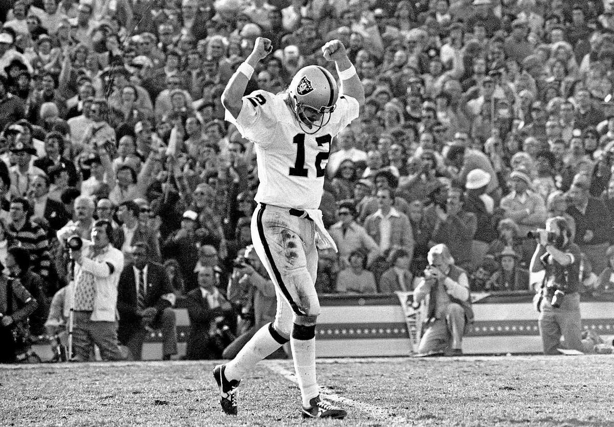 Raiders quarterback Ken Stabler celebrates a touchdown pass en route to his team's 32-14 victory over the Minnesota Vikings in Super Bowl XI.