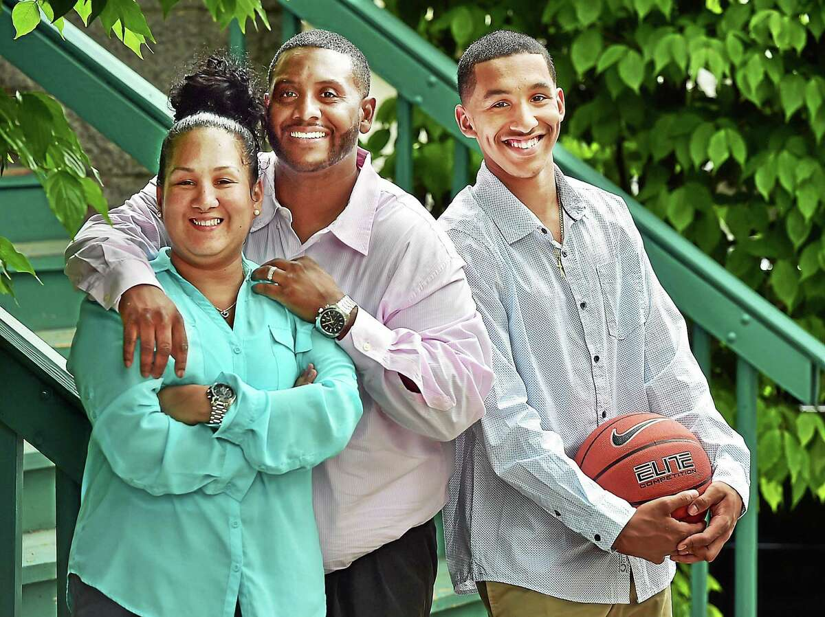 CATHERINE AVALONE — NEW HAVEN REGISTER Vanessa, Edward and Tremont Waters, 17, of New Haven.