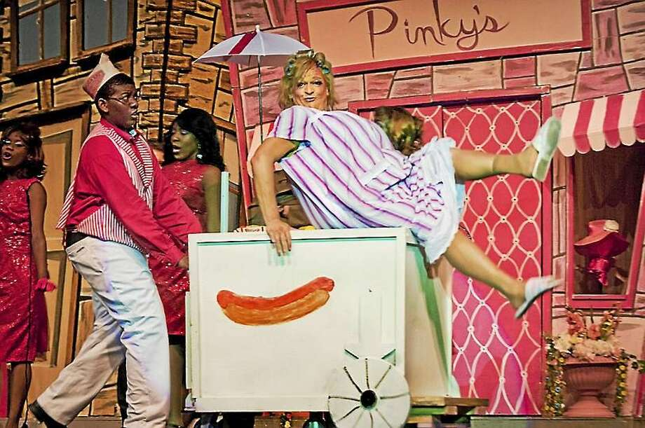 MELANIE STENGEL — NEW HAVEN REGISTER FILE PHOTO  Rick Hribko reprises his role as Edna Turnblad, right (shown in a previous version). Isiah Bostic, who played the hot dog vendor, will be appearing in this production as Seaweed J. Stubbs. Photo: Journal Register Co.