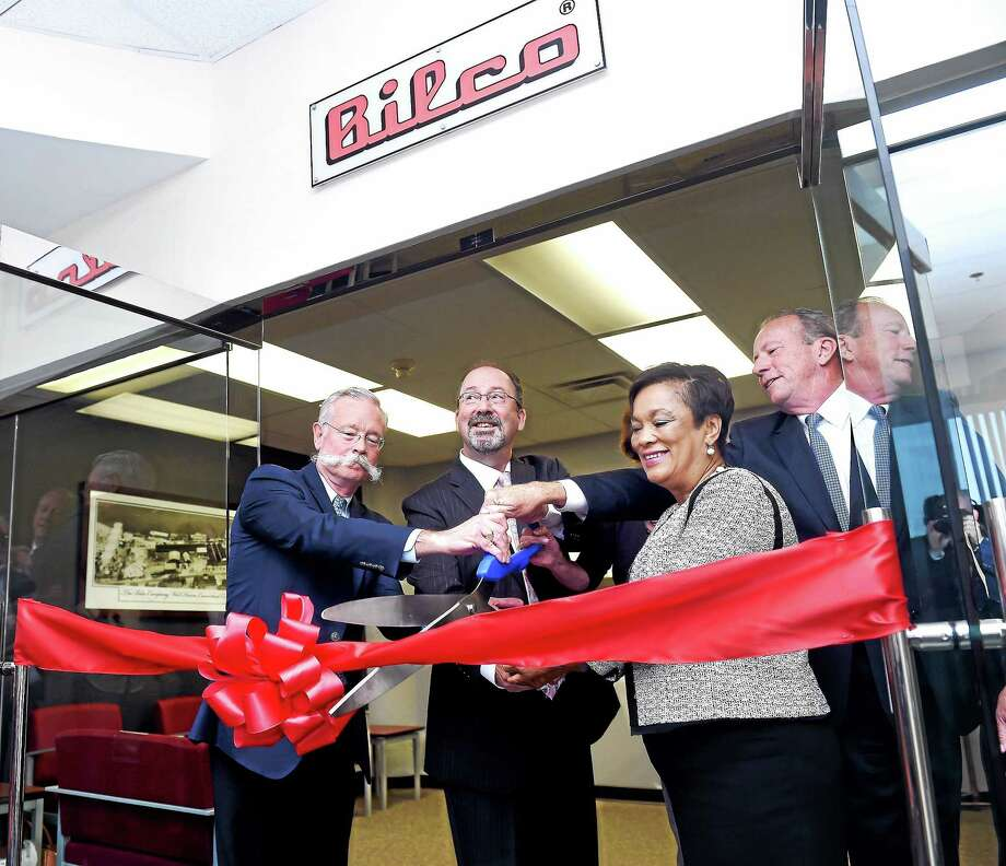 From left, Robert Lyons, CEO of the Bilco Co.; Tom Crowley, president of Bilco; New Haven Mayor Toni Harp; and Roger Joyce, Bilco's senior vice president, cut a ribbon at the company's new location on James Street in New Haven Monday. Hidden from view is Pamela Lyons Griffin, Bilco's vice president of finance. Photo: Arnold Gold — New Haven Register