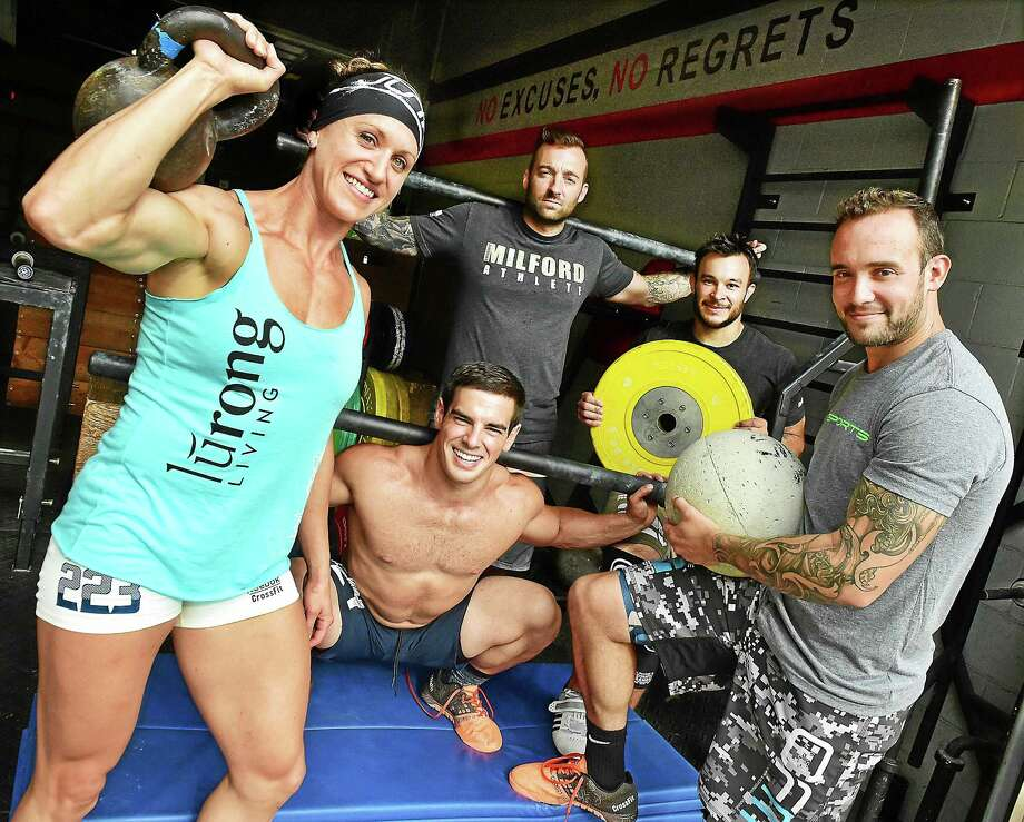 Jason Leydon, 35, owner of Crossfit Milford, standing center, and members of his Crossfit Milford team Katie Steffens, Paul Buono, Brendan Marolda and and Ryan Kononchik. Team members Bailey Garrett and Kaleena Ladeairous were not available for the photo. Photo: CATHERINE AVALONE — NEW HAVEN REGISTER   / New Haven RegisterThe Middletown Press