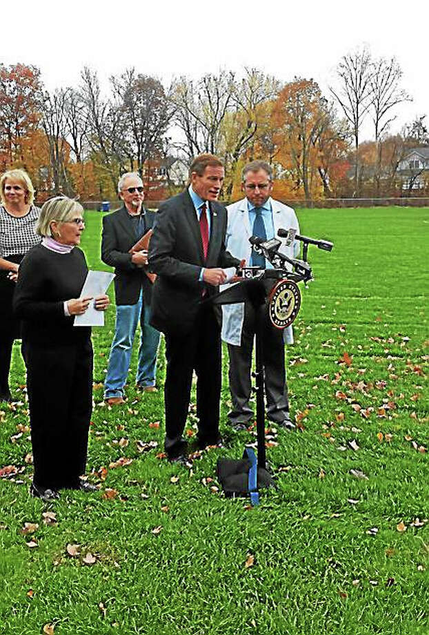 U.S. Sen. Richard Blumenthal (D-Conn) is joined by Nancy Alderman (left) of Environment and Health Inc. and Dr. Homero Horari of Mount Sinai Hospital in New York City to discuss the potential dangers of crumb rubber pieces in synthetic turf fields. Photo: Anna Bisaro — New Haven Register
