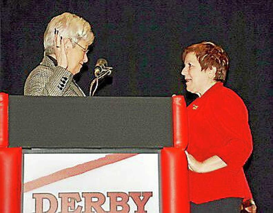 Derby Mayor Anita Dugatto, right, is sworn in to a second term Saturday by Lt. Gov. Nancy Wyman. Photo: JEAN FALBO-SOSNOVICH — NEW HAVEN REGISTER