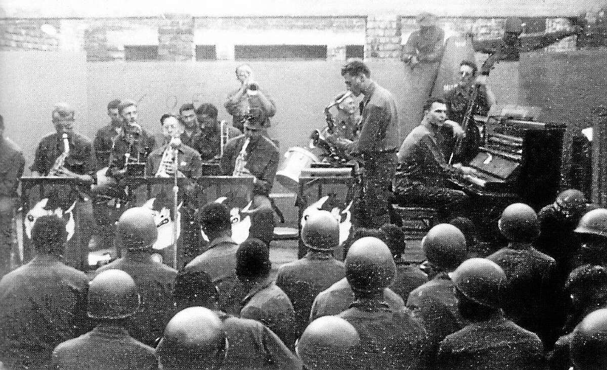 Dave Brubeck, at piano, performing for troops during World War II. Pvt. Brubeck, a rifleman with Patton's Army, started the first integrated band in the U.S. Army, which was known as the Wolf Pack Band.