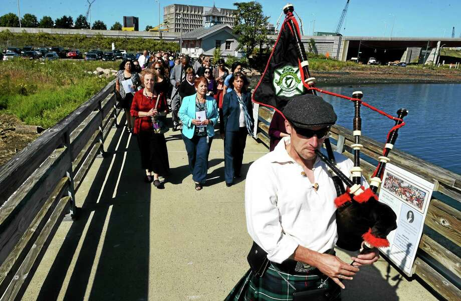 Bagpiper Jason Hall of the New Haven County Firefighters Emerald Society leads a procession on Long Wharf Pier in New Haven at the 16th annual Sound of Hope vigil to honor and remember survivors and victims of domestic violence, sponsored by the Umbrella Center for Domestic Violence Services, Wednesday in New Haven. Photo: Peter Hvizdak — New Haven Register   / ©2015 Peter Hvizdak