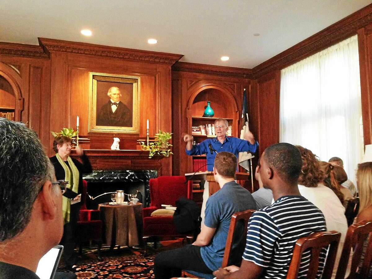 History professor David Blight, rear right, speaks about John C. Calhoun Wednesday at Yale University's Calhoun College. Calhoun Master Julia Adams is at rear left.