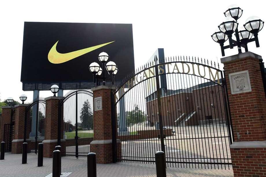 A Nike Swoosh is displayed on a digital billboard outside of Michigan Stadium in Ann Arbor, Mich. Photo: AP Photo/The Ann Arbor News, Melanie Maxwell   / The Ann Arbor News