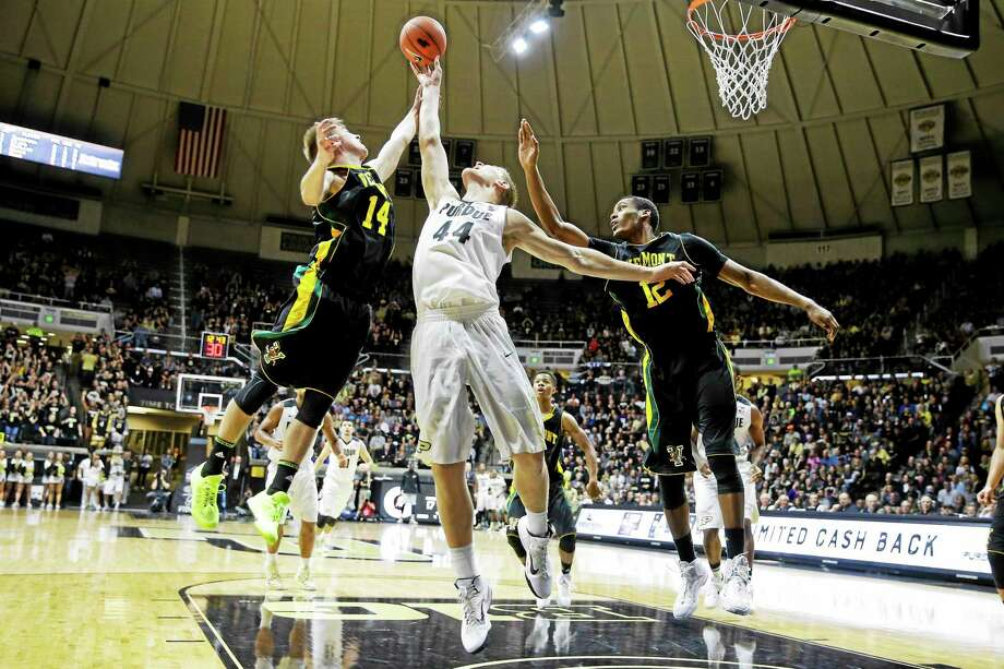 Shown here in a game against Purdue earlier this season, Vermont forward Darren Payen, right, battles for a rebound. Photo: The Associated Press File Photo   / AP