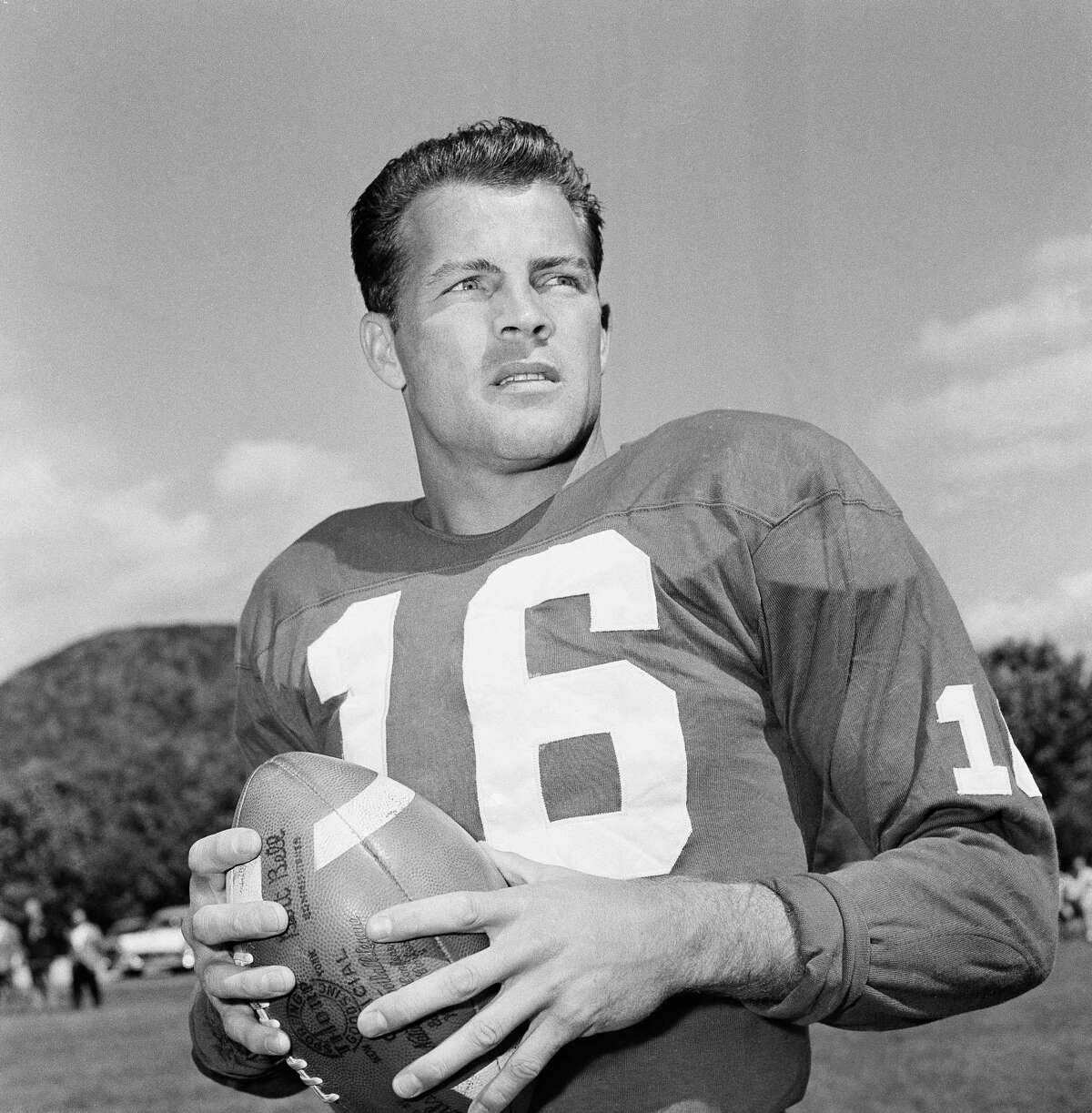 In this Sept. 9, 1958 file photo, New York Giants halfback Frank Gifford participates in a workout in New York. Gifford's family on Sunday said he died suddenly of natural causes. He was 84.