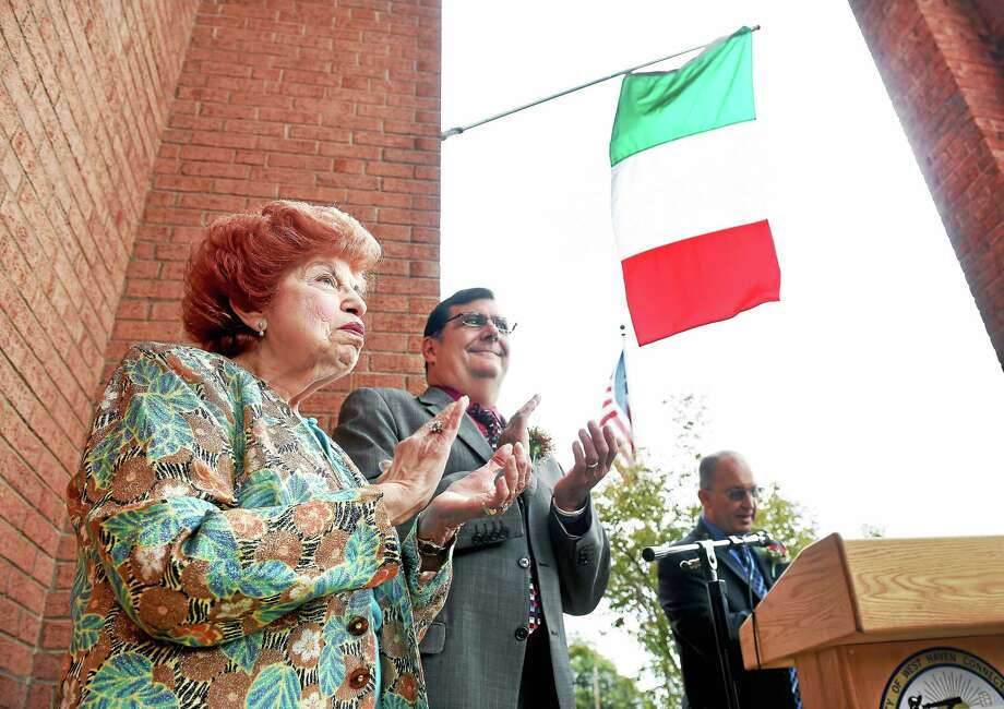 Marie Lacobelle left, was honored as West Haven's Italian-American of the Year at the Columbus Day Celebration in front of City Hall in West Haven Friday. At center is West Haven Mayor Ed O'Brien. Photo: Arnold Gold — New Haven Register