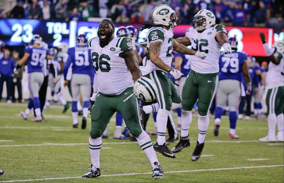 Muhammad Wilkerson (96) and Darrin Walls celebrate after the Jets beat the Giants in overtime on Sunday. Photo: Julie Jacobson — The Associated Press   / AP