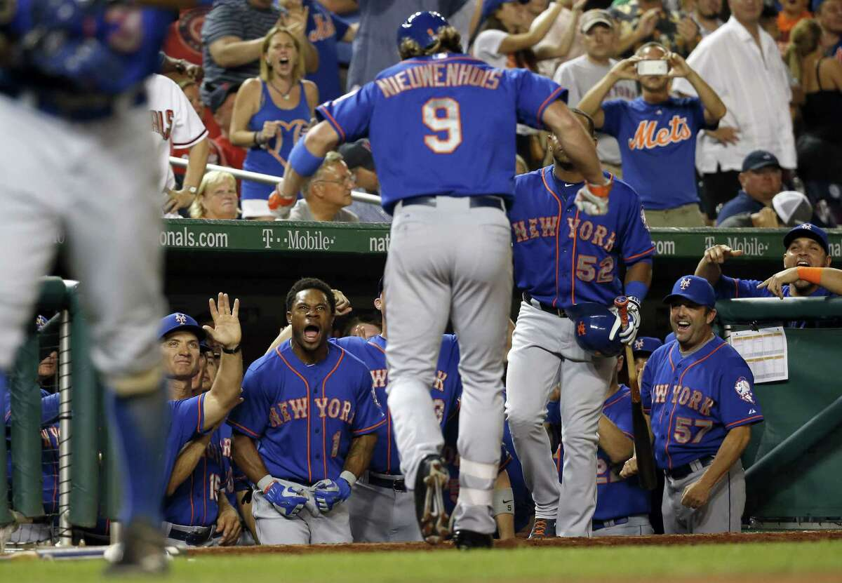 The Mets' Kirk Nieuwenhuis (9) celebrates his home run as he returns to the dugout in the eighth inning.