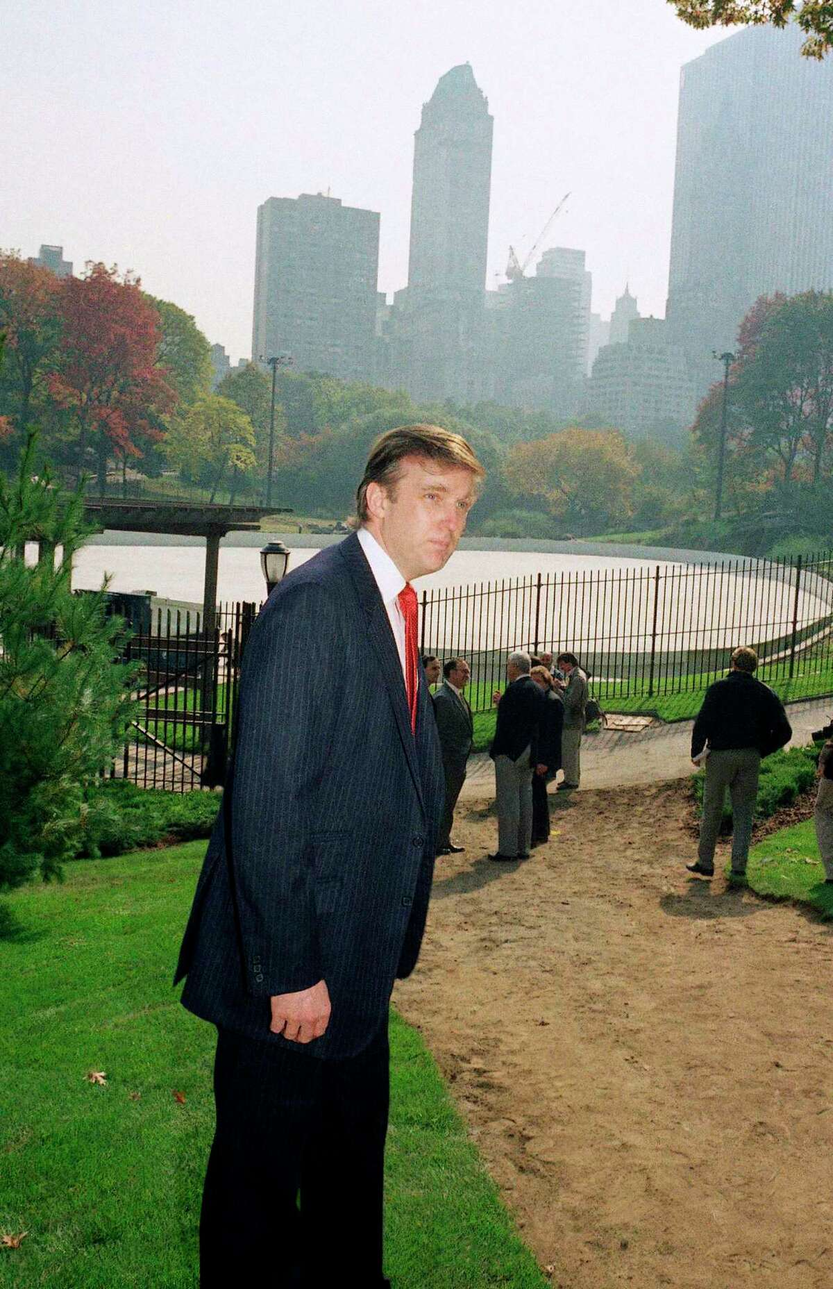 In this Oct. 23, 1986 photo, Donald Trump is photographed in New York's Central Park, in front of the Wollman Skating Rink, which he offered to rebuild after the city's renovation effort had come to a standstill.