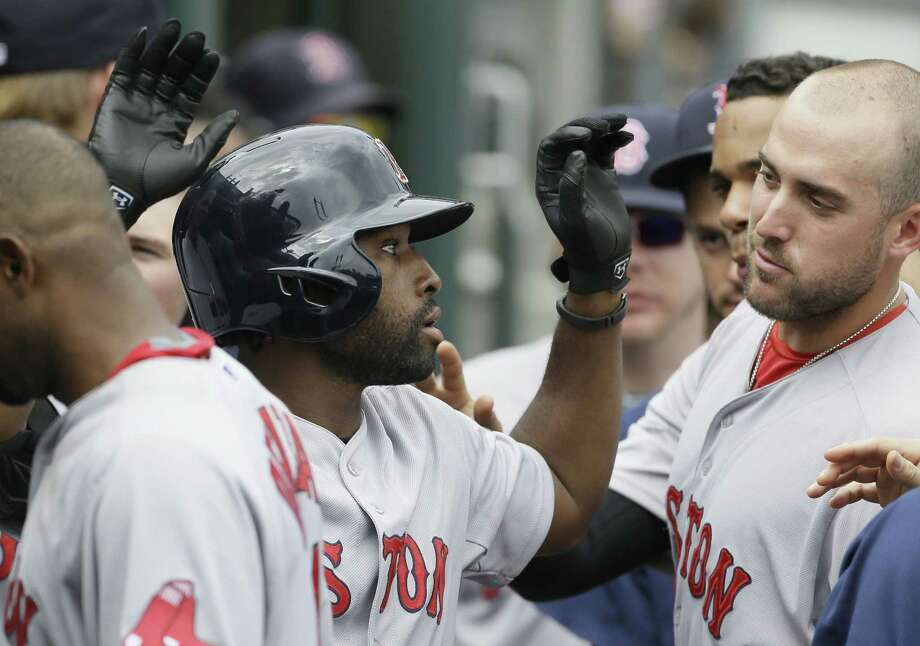 Red Sox outfielder Jackie Bradley Jr. is congratulated by teammates after his solo home run during the seventh inning of Boston's 7-2 win over the Tigers on Sunday in Detroit. Photo: Carlos Osorio — The Associated Press   / AP