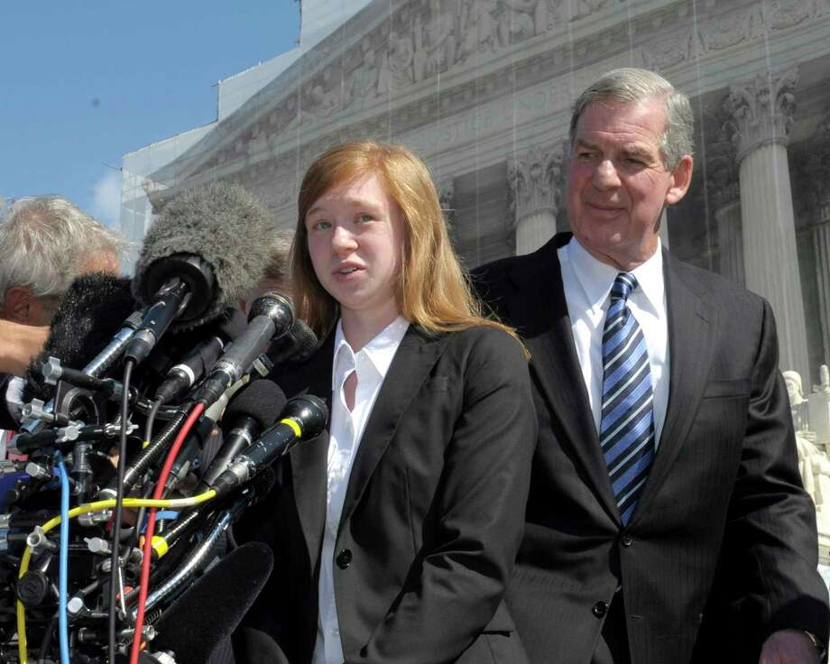 In this Oct. 10, 2012 photo, Abigail Fisher, the Texan involved in the University of Texas affirmative action case, accompanied by her attorney Bert Rein, talks to reporters outside the Supreme Court in Washington. Photo: AP Photo/Susan Walsh   / AP