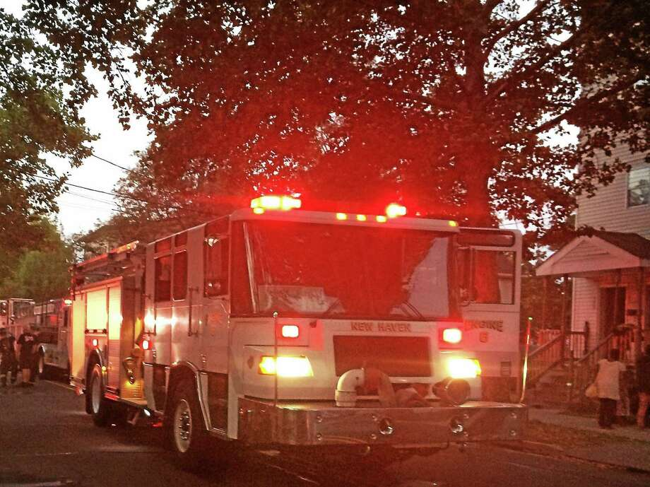 Eight people were displaced from 542 Winchester Ave. after a stove fire broke out there early Tuesday. There were no injuries and investigators were still working to find the cause of the fire. Photo: (Wes Duplantier -- New Haven Register)
